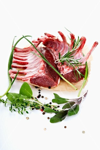 Raw lamb chops with various herbs and spices