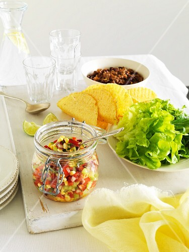 Corn salsa, taco shells, lettuce and chillis