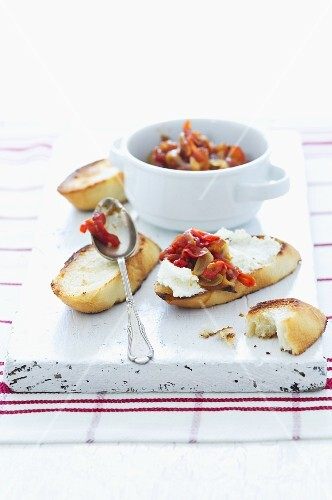 Toasted bread with cream cheese and chilli and tomato chutney