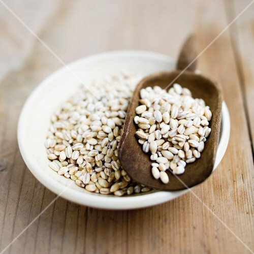 Pearl barley in a bowl and in a scoop