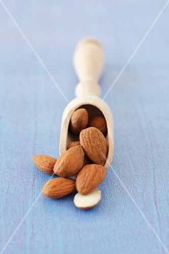 Almonds on a wooden scoop
