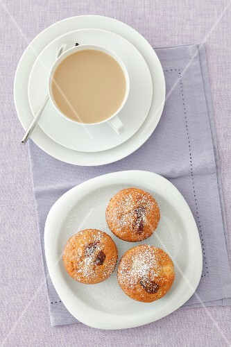 Apple muffins with dried figs and a cup of coffee