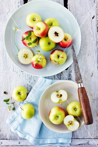 Apples, whole and cut into pieces