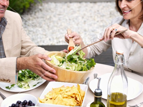 Couple having lunch in garden