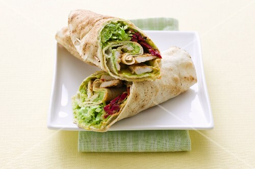 Wraps with grilled chicken, avocado and red beets