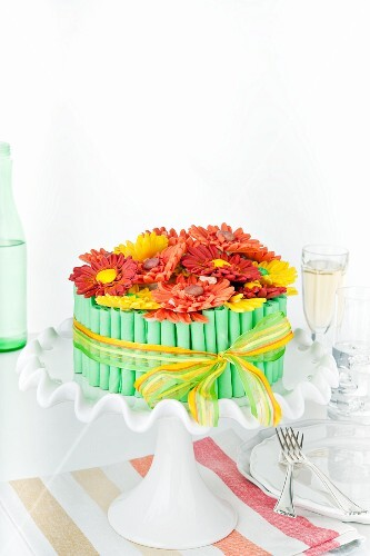 A birthday cake decorated with sugar gerberas