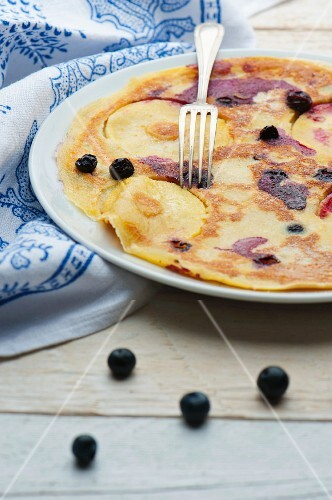 Apple and blueberry pancakes with a fork