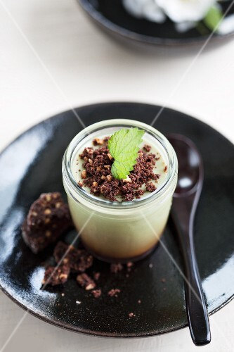 Panna cotta with matcha tea and chocolate biscuit crumbs