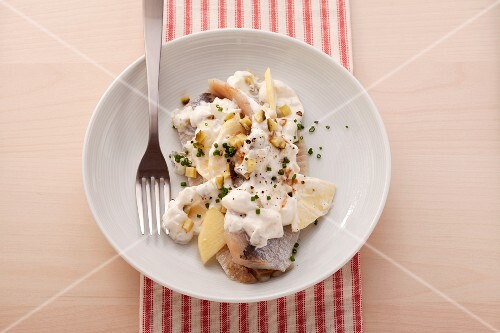 Soused herring with a creamy spiced sauce made with apples and yogurt
