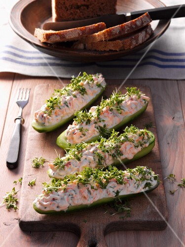 Cucumber boats filled with prawns and cress