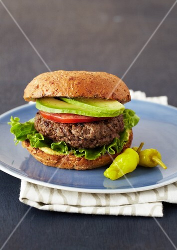 A Hamburger with Lettuce, Tomato and Avocado Slices