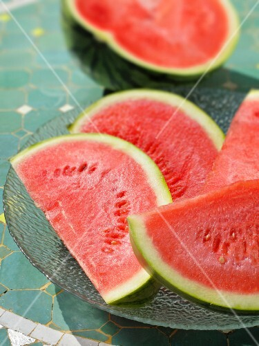 Watermelon wedges and half a watermelon