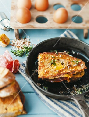 Fried bread with salami and egg