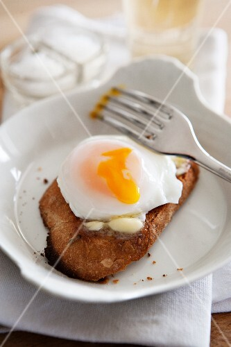 Poached egg on a slice of buttered bread