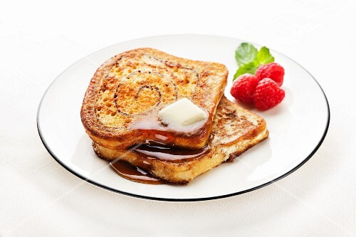 Cinnamon Swirl French Toast with Butter and Maple Syrup – StockFood
