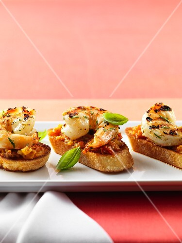 Bruschetta topped with grilled shrimps