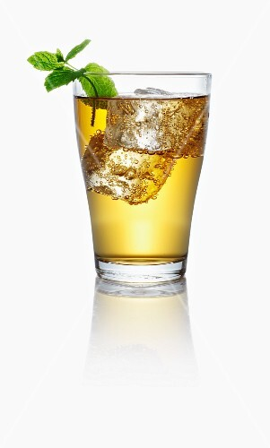 Apple juice spritzer with ice cubes and mint