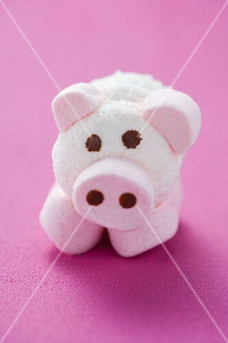 A pig made of coconut marshmallows on a pink surface