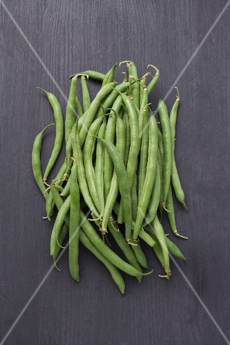 Green beans on a wooden background