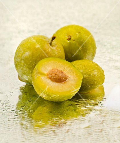 Greengages on a mirror