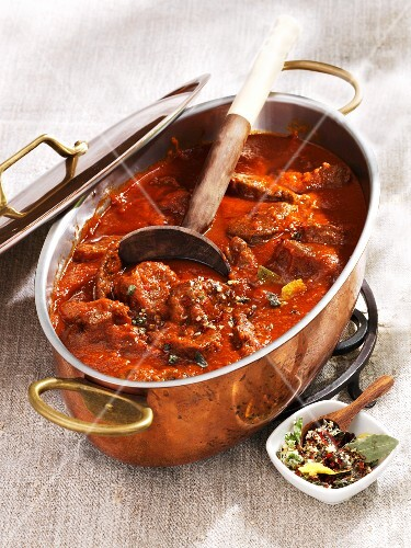 Beef goulash in a copper pot