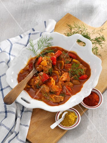 Pork knuckle goulash with pepper and dill
