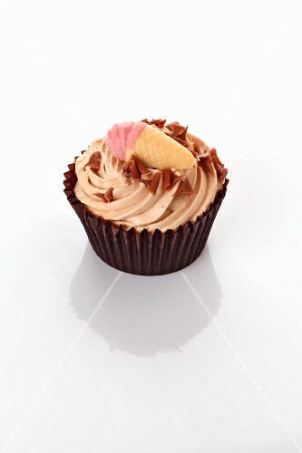 A cupcake decorated with an ice cream cone