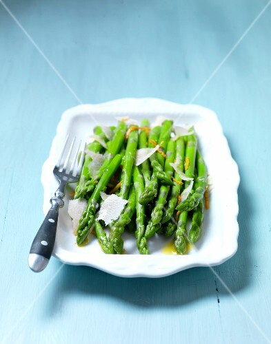Green asparagus with orange butter and a Parmesan grater