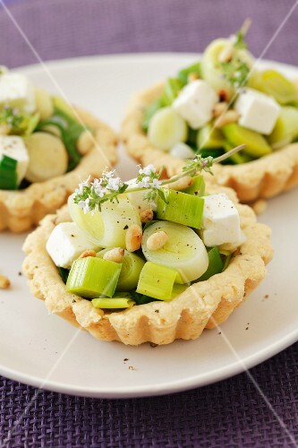 Leek, feta cheese and pine nut tartlets
