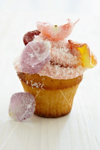 Cupcake with rose petals and grated coconut