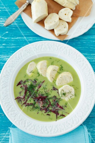 Cream of pea soup with radicchio and quark dumplings