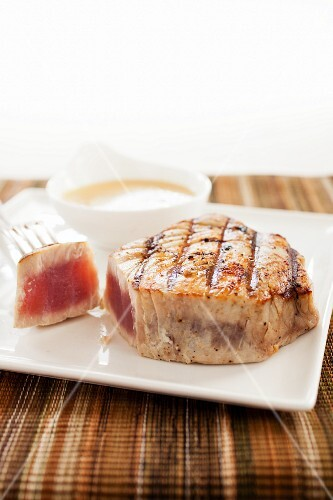 Grilled Sliced Tuna on a White Plate; Shredded Veggie Salad