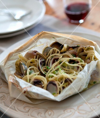 Spaghetti and Clams Cooked in Parchment Paper Pouch