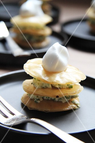 Puff pastry towers with herb sauce