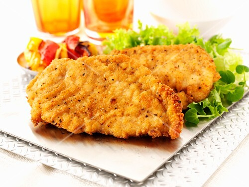 Bread chicken escalopes with a side salad