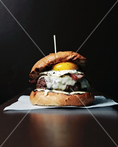 A Hamburger with Cheddar Cheese, Thick Cut Bacon and a Fried Egg