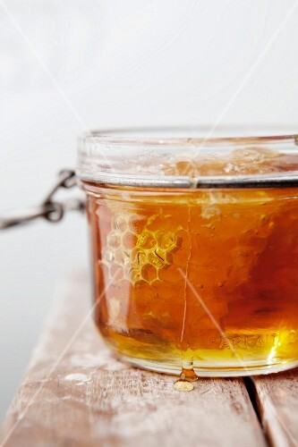 Honey and Honeycomb in a Glass Jar