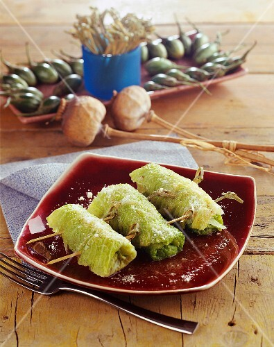 Savoy cabbage rolls filled with ham