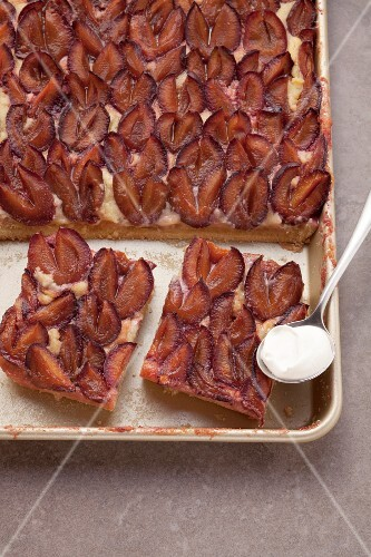Plum cake on a baking tray
