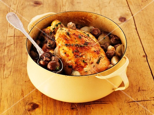 Chicken with mushrooms in a pot