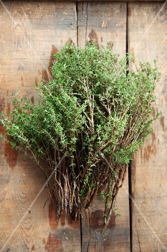 Fresh thyme on a wooden table