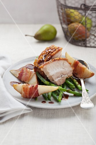 Crackling roast of pork with pears, beans and bacon