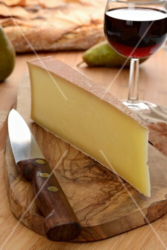 Abondance cheese from France, red wine, pears and bread