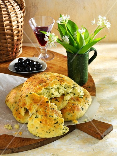 Potato and ramson bread and a dish of olives