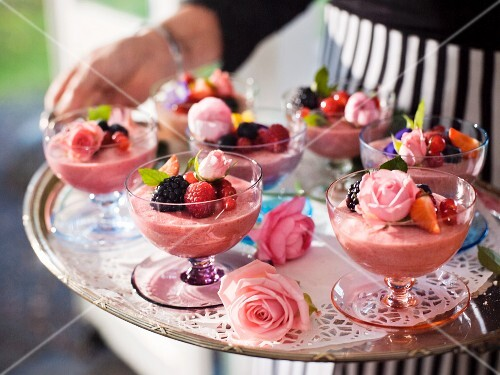 Summery raspberry mousse with roses and a berry garnish