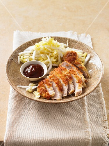 Breaded chicken breast with cabbage salad and barbecue sauce