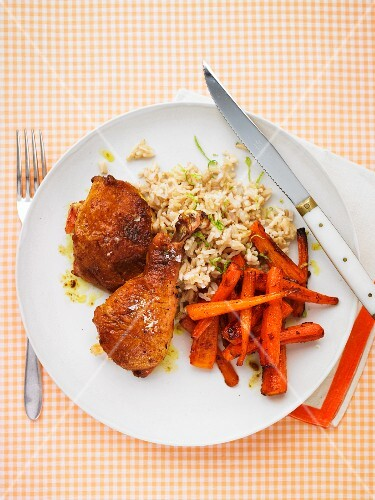 Chicken legs with curry, carrots, rice and lime zest