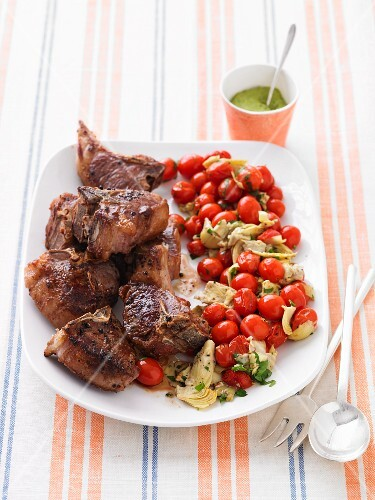 Lamb chops with fried tomatoes and artichokes