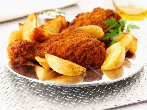 Spicy breaded chicken legs with potato wedges