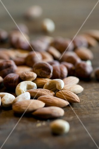 Mixed nuts on a wooden surface